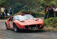 Scora GT, three-wheeling around a bend.