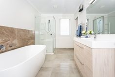 Having a functional and streamlined bathroom design is important, making it easier to clean the area and arrange items in a well-organized manner. New Shows, Bathrooms, This Is Us, Shower, Interior Design, House, Rain Shower Heads, Nest Design, Bathroom