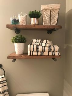 Floating shelves add a rustic but contemporary look to your home or work space. The handcrafted, solid wood shelves and sleek iron pipe supports provide sturdy storage for books, dishes, or bathroom décor in a cozy, farmhouse style. Diy Wooden Shelves, Solid Wood Shelves, Wooden Diy, Rustic Shelves, Wood Bathroom, Diy Bathroom Decor, Diy Home Decor, Bathroom Ideas, Bathroom Organization
