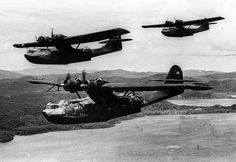 Three US Navy PBY-5A Catalina aircraft of VP-52 in flight in the southwest Pacific, Dec 1943.