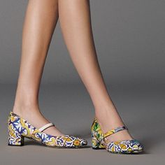 These are SO cute! The heel doesn't look too high and the pattern is really original for shoes!! :)