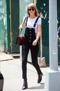 Show off your flirty style by playing with proportions. Taylor showed a slip of skin when she layered her l...