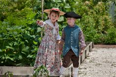 Boy and girl in the Powell House garden.  Colonial Williamsburg's Historic Area,  Williamsburg, Virginia Photo by David M. Doody