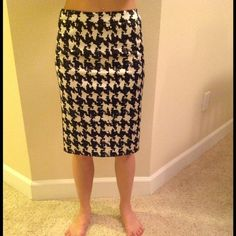 Moschino 100%authentic black and white skirt Moschino skirt with black and white design. Fully lined with back slit. Beautiful design and definitely a classic piece. Size 6. 100% authentic. Great condition with no rips, tears or stains. Moschino Skirts