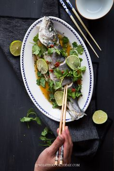 Learn how to make delicious steamed whole fish dressed with Thai-style dressing and plenty of fresh herbs that will whet your appetite. Whole Fish Recipes, Asian Fish Recipes, Thai Recipes, Asian Seafood Recipe, Seafood Recipes, Cooking Recipes, How To Cook Steamers, Lemon Fish, Fusion Food