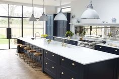 black cabinets and marble countertop kitchen