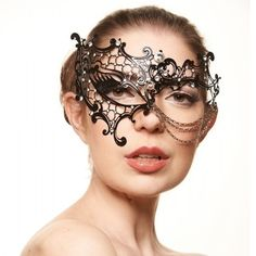 Phantom of the Opera Inspired Mask with Chains -Made with eco-friendly metal material. -Laser Cut -Beautiful Rhinestones design.  -One size fits most. -Perfect for masquerade balls, weddings, proms, parties, dances, music festivals, raves, Mardi Gras, etc. K2013 Jewelry