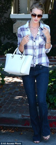 Mad for plaid: The Transformers star sported a checked button-down and wide flare jeans as...