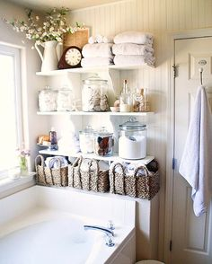 "The Nest on Instagram: ""If you're fighting to find space in your bathroom, add shelves to store bath time products and beauty essentials! We love how this bathroom utilizes wicker baskets and glass jars for storage  via @ellaclaireblog #bathroomdecor #storageoptions"""