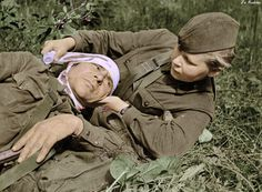 Soviet Medic SG Skotinkina bandaging a wounded soldier - North Western Front 1942   by Za Rodinu