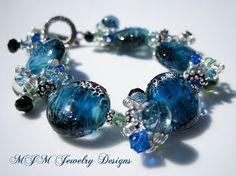 Turning Tides  Glass Bead Charm Bracelet by mjmjewelrydesigns