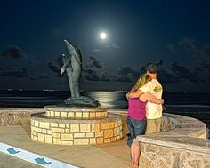 A couple enjoys a dazzling full moon over the Gulf.  Do you agree that it's Island time?