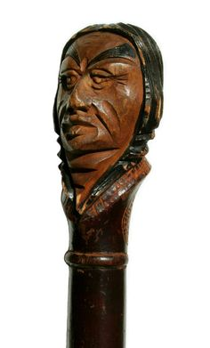 Carved wooden walking stick was once the property of Dartmouth student Arthur W. Tucker jr. of the class of 1937. Decorated with the original incised insignia of Alpha Sigma.