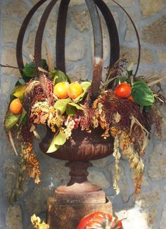 Fall Urn...Love the use of metal strapping from wine barrels to make the architectural sphere.