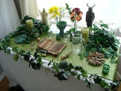 I'm loving this super green Beltane altar! Mabon, Samhain, Wicca Altar, Home Altar, Altar Decorations, Sabbats, Witch Aesthetic, Book Of Shadows, Magick