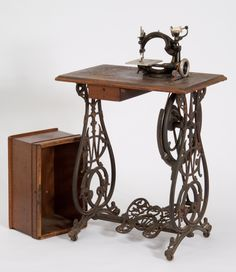 Willcox and Gibbs treadle base.  I love how the irons are so pretty and ornate and the foot peddle looks like a butterfly or two feet, depending on how you look at it.  I can't find a picture of the cabinet I have that was made for the machine.