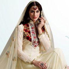 Dazzling Diva Buttercream Salwar Kameez in net and silk fabrics. Price:£72
