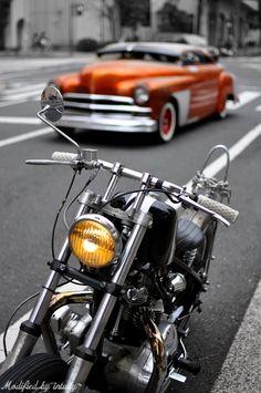 Motorcycle and the old car Would of focused on the car here but love the concept