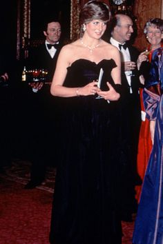 MARCH 1981 – For her first official engagement at Goldsmiths Hall in London, Lady Diana wore a strapless silk taffeta gown.
