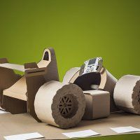 There's something so satisfying about a cardboard box. Remember getting a new toy and spending hours playing with the box instead? Even pets know the joy Cardboard Car, Cardboard Playhouse, Cardboard Sculpture, Cardboard Furniture, Cardboard Crafts, Paper Craft, Diy For Kids, Crafts For Kids, Children Crafts