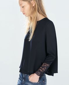Image 1 of TOP WITH EMBROIDERED CUFF from Zara