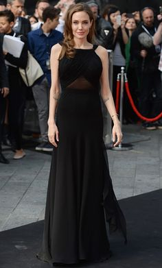 Angelina Jolie wowed a gorgeous gown with her first public appearance after her major surgery! Premiere of World War Z, in London.