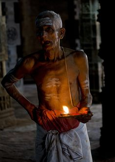 Priest With Traditional Painting On His Forehead Holding A Candle In The Airavatesvara Temple, Darasuram, India   Flickr - Photo Sharing!
