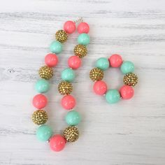 Coral mint and gold bubblegum necklace, sparkle necklace, bubblegum bracelet, kids necklace, baby necklace, coral and gold birthday, coral 1st birthday, girl birthday gift, Christmas gifts for girls, birthday outfit, matching necklace and bracelet, baby fashion, kids fashion, stylish kids, trendy kids, kids accessories, etsy jewelry, etsy kids, #bubblegumnecklace https://www.etsy.com/listing/464320581/coral-mint-and-gold-bubblegum-necklace