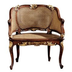 Features:  -Rattan chair.  -Hand carved.  -Double caned seat.  -Design Toscano exclusive.  -Solid mahogany construction.  -Hand finished.  Frame Finish: -Mahogany.  Frame Material: -Wood.  Arm Materia