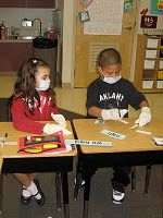 Contraction Surgery During our study of contractions, my students performed Word Surgery.  First we dressed the part with our masks and gloves.  They gathered tools such as scalpel (scissors), stitches (tape), and bandages (Band-Aids).  Each team assisted each other during surgery.  They cut off the letters they didn't need and bandaged them back together with Band-Aids and tape.  I wanted them to always remember how to form a contraction.  They had a lot of fun doing it.  They were very excited to take home their surgery gear.  I even overhead one of my students saying they were going to make their own word cards and try it again at home!