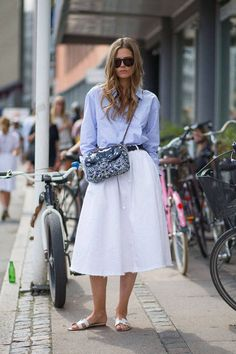 Caroline Brasch Nielsen proves everyone's favorite skirt length works just as well with flats as heels while strolling the streets between shows at Copenhagen Fashion Week.