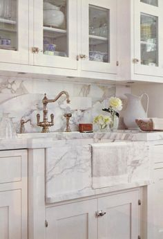 should we get a drop in stainless sink and then have a piece of the marble plastered to it like this.