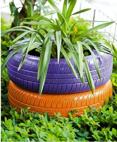 could do half a tire on the bottom, whole on top on the bank... Love the paint...Tires as Decoration | Design & DIY Magazine