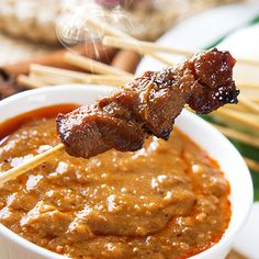 A grilled pork satay recipe with a lovely peanut sauce.. Grilled Pork Skewers With Peanut Basil Sauce Recipe from Grandmothers Kitchen.
