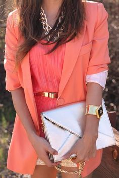 Make a statement with coral and gold accessories.