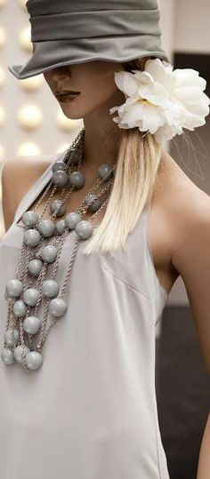 Statement necklace + hat + white flower..<3