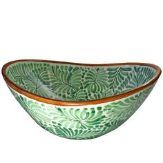 This collectible art sink is an elegant oval shape vessel sink with a gorgeous leaf motif inside and out with a brown edge trim. This stunning hand-painted Mexican ceramic sink by Gorky Gonzalez will add a unique and lovely look to your bathroom or powder room.