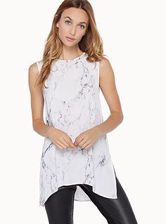 Exclusivité Twik     L'inspiration athlétique d'une longue blouse avec zip…