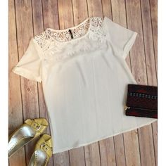 Elegant lace short-sleeve blouse A lacey inset at the shoulders gives this beautiful top very special detail. It is light and elegant for the spring and summertime! Please refer to size chart to determine your size. I am usually comfortable in a medium (between sz 6-8) and I would probably size up in this top. Posh by Nina Tops Blouses