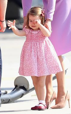 Princess Charlotte was seen less happy, after taking a tumble on the tarmac, that didn't stop the youngster to fulfill her royal duties as she views helicopter models H145 and H135 before departing from Hamburg airport on the last day of their official visit to Poland and Germany