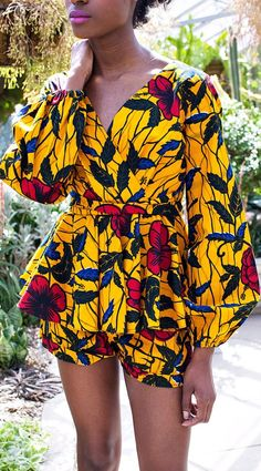THE XOLI Shorts in Golden Hibiscus. The Hibiscus flower is found in tropical regions worldwide and has come to be associated with sacred feminine energy, healing and sexuality.   Ankara | Dutch wax | Kente | Kitenge | Dashiki | African print bomber jacket https://uk.pinterest.com/925jewelry1/women-sunglasses/pins/