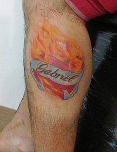 Tatuagem de coração sagrado em homenagem ao filho
