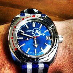 """Vostok """"Blue Diver / Scuba Dude"""" on blue & white Nato strap."""