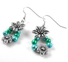 Floral drop down earrings made from the Spoilt Rotten Beads Bumper Kit! Shop now at C+C: http://www.createandcraft.tv/pp/spoilt-rotten-beads-bumper-kit-with-instructions-343194?referrer=search&fh_location=//CreateAndCraft/en_GB/$s=343194 #jewellery #handmadejewellery