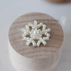 Small pearl snowflake for decorating wedding invitations and DIY wedding stationery. Make your own winter theme wedding stationery. Paper craft supplies. Winter wedding