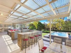 Outdoor kitchen and entertaining area with tiled covered patio with clear laserlight roofing . #outdoorkitchens #bbqarea #roofing
