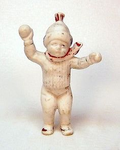 "antique bisque snow baby boy throwing a snowball  2-1/2"" high"