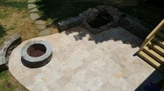 Lake Norman patio and fire pit with a water fall by Archadeck of Charlotte coming off of a deck