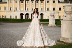 Splendid wedding gown Angelina made of beautiful lace covering tender net with coffee shade. V- neck emphasizes your noble bearing and full ball skirt falling to the floor make an impression of captivating beauty. The back of the dress is open and buttoned up.
