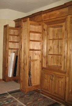 Pull-out long gun storage.hubby would LOVE this Gun Storage, Safe Storage, Hidden Storage, Tall Cabinet Storage, Hidden Gun Cabinets, Reloading Room, Gun Rooms, Hidden Rooms, The Ranch